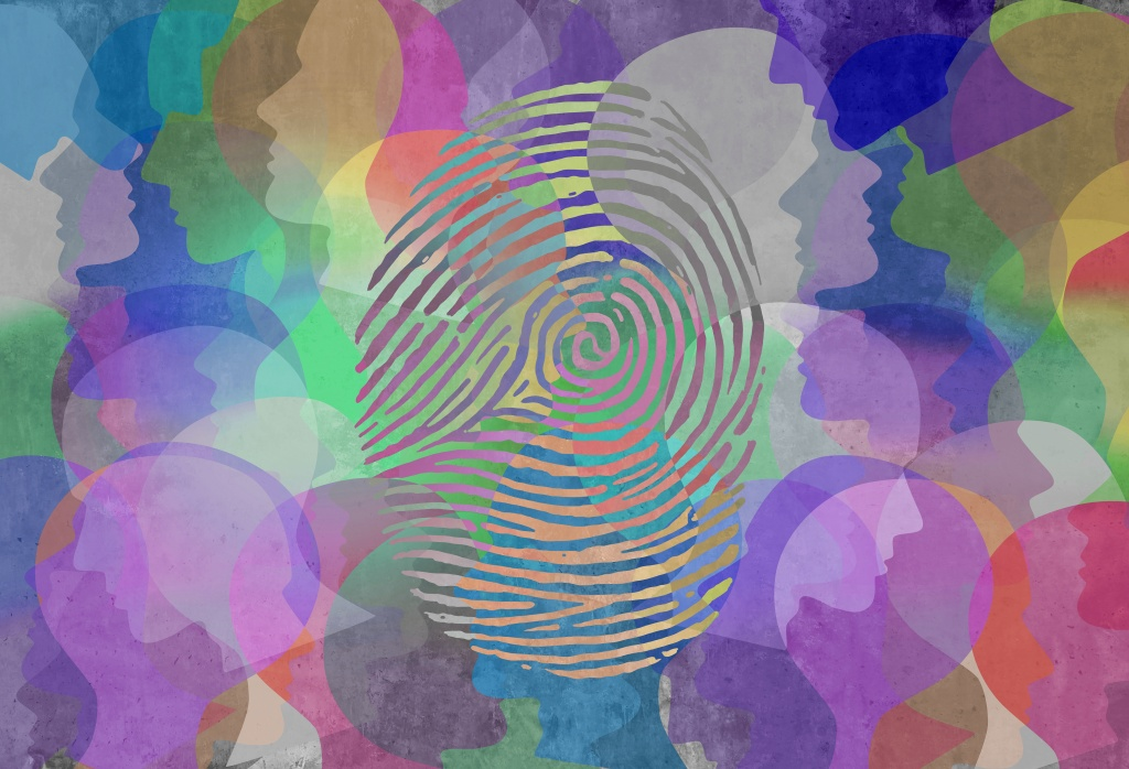 A fingerprint impressed upon a swirl of colorful heads, representing the effort in therapy to make sense of oneself and their identities amongst the greater community.